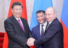 Си Цзиньпин принял участие в 5-й встрече руководителей Китая, России и Монголии